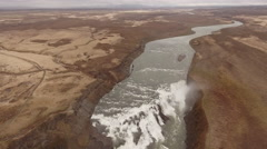 Brown Cliff Waterfall Aerial Stock Footage