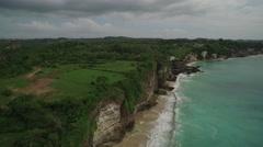 Beautiful 4K Aerial Drone footage Tilt Down Over Dreamland Beach Bali Indonesia Stock Footage