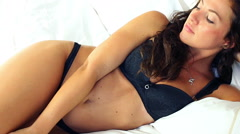 Black lingerie woman on bed awake in the morning Stock Footage