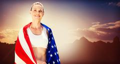 Portrait of american sportswoman is smiling  against composite image of lands Stock Photos