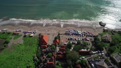 4K Aerial Tilt Up Drone Shot Old Mans Batu Bolong Beach Bali Indonesia Stock Footage