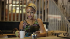 4K Happy young woman using computer tablet in city coffee shop Stock Footage