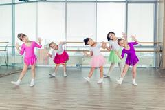 Happy children dancing on in hall, healthy life, kid's togetherness and Kuvituskuvat