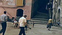 Capri 1957: people walking near the port Stock Footage