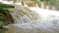 Waterfall in Luang prabang is Guangxi Waterfall over the turbid water Stock Footage