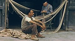 Capri 1957: fishermen working on their nets Stock Footage