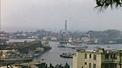 Genoa 1957: arriving in the city with a ship - stock footage