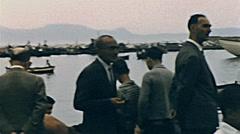 Capri 1957: men talking at the port Stock Footage