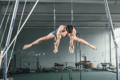 Gymnast on Stationary Rings - stock photo