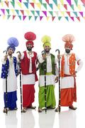 Sikh men posing with Khundis Stock Photos