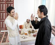 Muslim men greeting each other Stock Photos