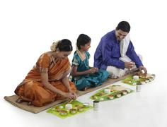 South Indian family having lunch Stock Photos