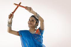 Gujarati woman performing dandiya Stock Photos