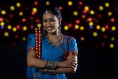 Gujarati woman with dandiya sticks Stock Photos