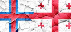 faroe islands flag with Georgia flag on a grunge cracked wall - stock illustration