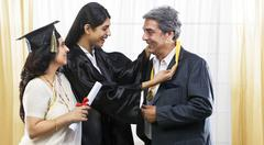 Girl putting her medal around her fathers neck Stock Photos