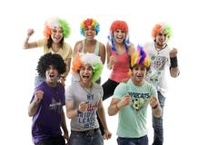 Youngsters with wigs cheering Stock Photos