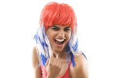 Portrait of a woman with a wig cheering Stock Photos