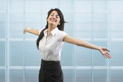 Businesswoman enjoying her freedom Stock Photos