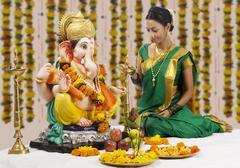 Woman performing a pooja Stock Photos