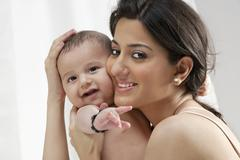Mother hugging her baby Stock Photos