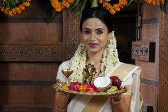 Portrait of a South Indian woman holding a tray Stock Photos
