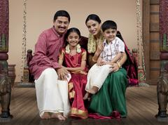 Portrait of a South Indian family sitting on a jhula Stock Photos