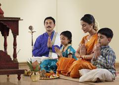 South Indian family praying Stock Photos