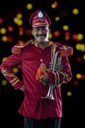 Portrait of a bandmaster holding a trumpet Stock Photos
