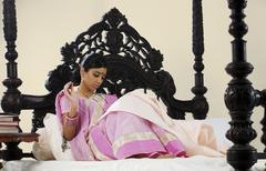 Bengali woman stitching Stock Photos
