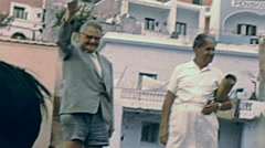Ischia 1957: people greeting a ship while leaving the port Stock Footage