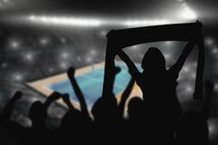 Silhouettes of football supporters against view of a tennis field - stock illustration