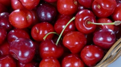 Cherries in basket rotating counter clockwise Stock Footage