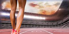 Close up of sporty legs against race track - stock photo
