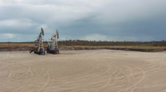 Oil and gas industry. Work of oil pump jack on a oil field Stock Footage