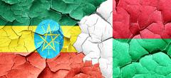 Ethiopia flag with Madagascar flag on a grunge cracked wall Stock Illustration