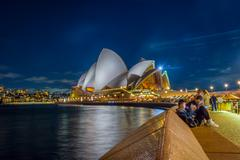 People by the Sydney Opera House at night Stock Photos