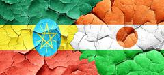 Ethiopia flag with Niger flag on a grunge cracked wall Stock Illustration