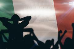 Composite image of silhouettes of football supporters Stock Illustration