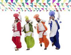 Sikh men dancing Stock Photos
