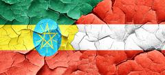 Ethiopia flag with Austria flag on a grunge cracked wall - stock illustration