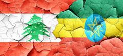 Lebanon flag with Ethiopia flag on a grunge cracked wall Stock Illustration