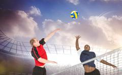 Composite image of sportsmen are playing volleyball in a stadium - stock photo