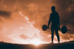 Bodybuilder lifting heavy barbell weights against landscape with sunset - stock illustration
