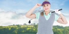 Pretty blonde playing golf against country scene Stock Photos