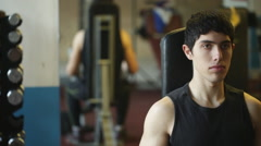 Dumbell workout in gym Stock Footage