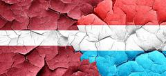 Latvia flag with Luxembourg flag on a grunge cracked wall Stock Illustration
