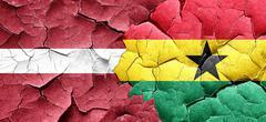 Latvia flag with Ghana flag on a grunge cracked wall Stock Illustration