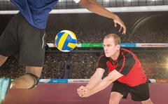 Composite image of sportsmen are playing volleyball in a stadium Stock Photos
