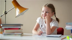 Girl ends up learning lessons, a student finish her homework, children's - stock footage